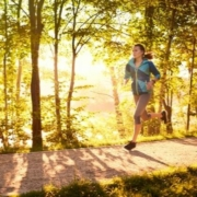Runner enjoys her morning run along a trail.