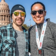 Couple poses in front of Texas State Capitol after 2019 3M Half Marathon. Get to know Austin when you visit the places in our blog, like the Texas State Capitol.