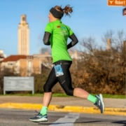 Participant runs through the University of Texas during the 2019 3M Half Marathon. 2020 participants can download the free half marathon training plan that'll get them to the finish line!