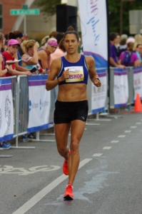 Image of Sarah Bishop running a race. She will run with the 2020 elite field at the 3M Half Marathon presented by Under Armour.