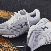 A pair of white Under Armour shoes: the HOVR Infinites.