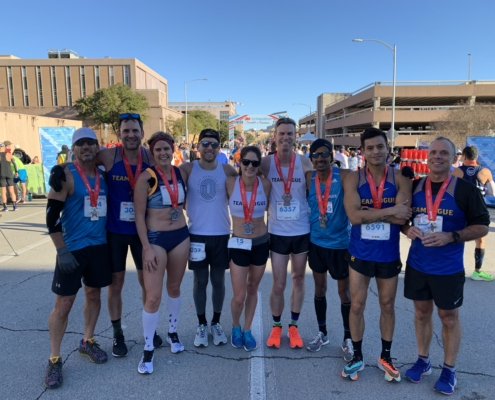 Members of Rogue Running pose for a picture at the 2020 3M Half Marathon. The 2020 3M Half Marathon presented by Under Armour provided plenty of PRs!