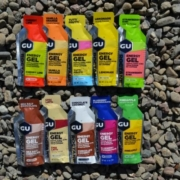 Image of 10 different flavored GU Energy Gels laying on the ground. GU Energy Labs is the Official Energy Gel and Chew of the 2020 3M Half Marathon presented by Under Armour.