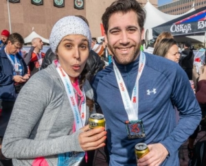 Image of two runners celebrating at the Oskar Blues Austin beer garden at the 2019 3M Half Marathon finish line festival. This blog has everything you need to get ready for the 2020 3M Half Marathon!