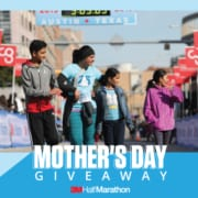 Image of a mother crossing the 2019 3M Half Marathon finish line with her three kids walking beside her. Enter your mom to the 3M Half Marathon Mother's Day Giveaway and she could win a free SPIbelt!