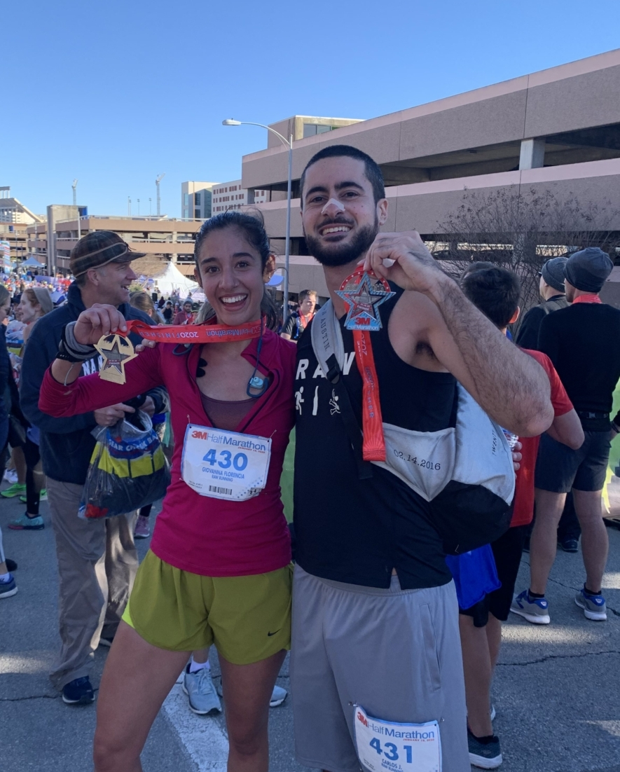 Image of a male and female runner showcasing their 2020 3M Half Marathon finisher medals at the finish line festivals. Run your first half marathon at 3M Half Marathon and cross your first 13.1-mile finish line and join runners like these two.