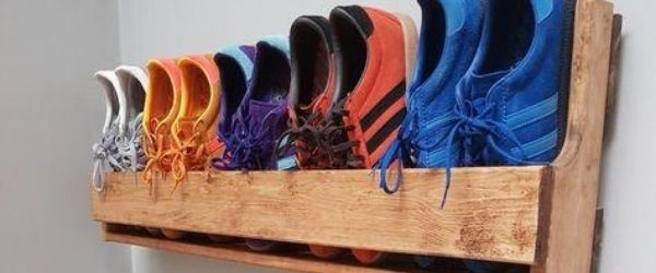 5 pair of running shoes are tucked into a hand-built wooden rack that hangs from the wall. It's an example of different ways to organize your running shoes. Click on the image's link to visit 3M Half Marathon's Pinterest page for more ideas.