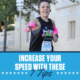 Female runner shows the peace sign with her right hand during the 2020 3M Half Marathon. Text on design reads Increase Your Speed with these 7 Tips. Learn more at https://downhilltodowntown.com/increase-your-speed/