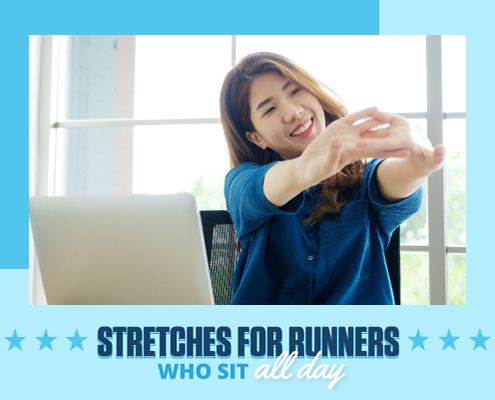 Woman stretches her arms out while sitting at a desk in front of her computer. Text in design reads Stretches for Runners Who Sit All Day. Learn more at https://downhilltodowntown.com/stretches-for-runners-who-sit-all-day/