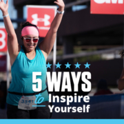 Female runner triumphantly crosses the 3M Half Marathon with her arms raised in the air. Text on design reads 5 Ways to Inspire Yourself. Read more at https://downhilltodowntown.com/inspire-yourself/