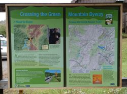 An educational panel describes the wildlife along the Green Mountain Byway.