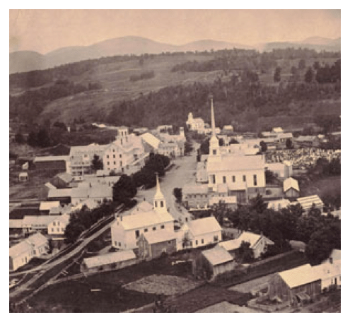 An black-and-white photo of a small Vermont village taken from the air.