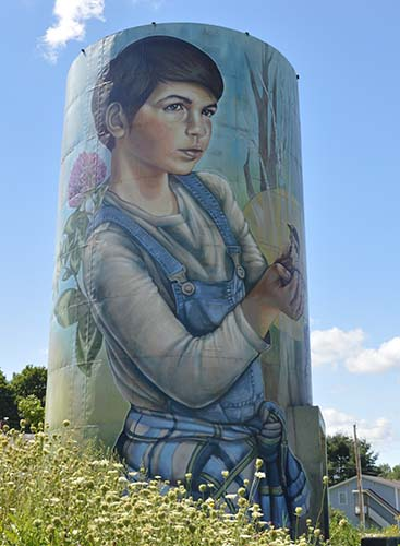 A painting of a boy on a 36-foot grain silo.