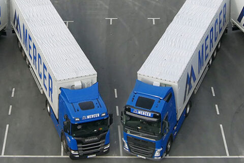 """Mercer Holz trucks parked in the parking lot of the Mercer Rosenthal pulp mill, forming the Mercer """"M"""""""