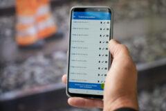 Mercer Holz team member using the LoadMonitor system on mobile