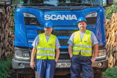 Two Mercer Holz drivers with new Scania Timber Truck with loading crane