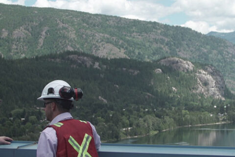 Two Mercer Celgar employees overlooking the Nelson River in British Columbia, Canada, from the pulp mill's roof