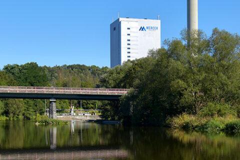 Mercer Rosenthal mill across a river in Rosenthal am Rennsteig, Germany