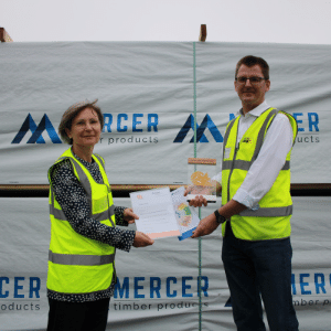 """BGHM Erfurt presents the """"Clever Fox"""" trophy to Mercer Timber Products Managing Director, Dr. Carsten Merforth."""