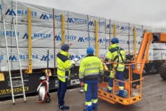 Mercer Timber Products team members using new crane arm technology to assist in loading lumber pallets more safely