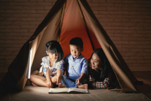 A young boy with Dyslexia and his sister and mother practice reading together.