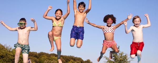 Children have fun swimming during Summer break