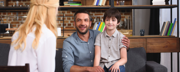 Father and son discuss IBHS with his son's therapist.