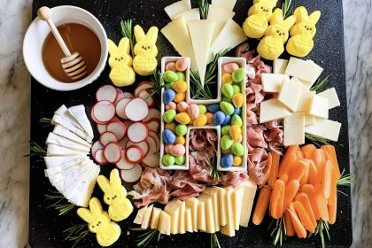 charcuterie board with easter candy on a marble background