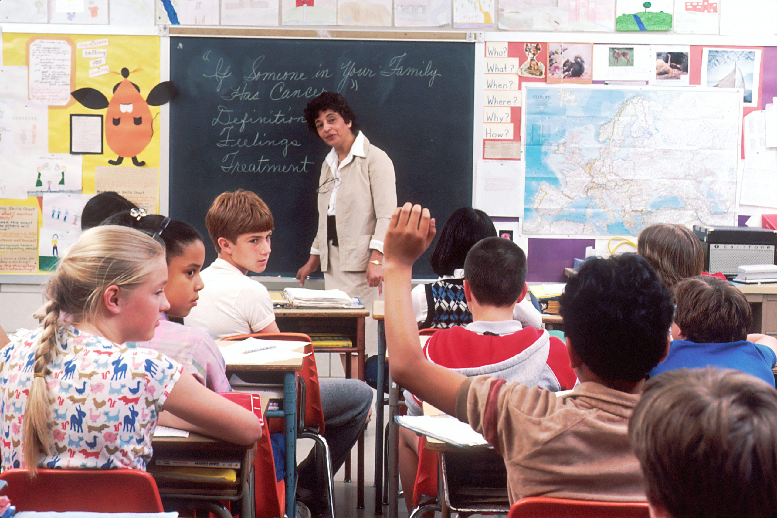 Stock-Teacher-teaching--scaled
