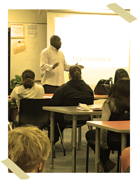 Founder Nate Cooper speaking in front of Students at Phoenix Academy