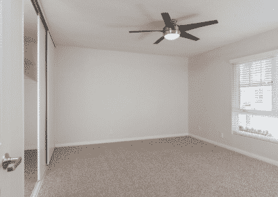 Avignon Apartment Homes Empty Master Bedroom with window and Ceiling Fan