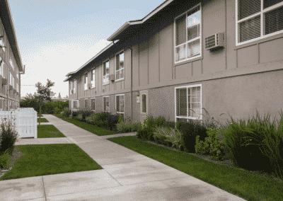Grassy walkway at Avignon Apartment Homes