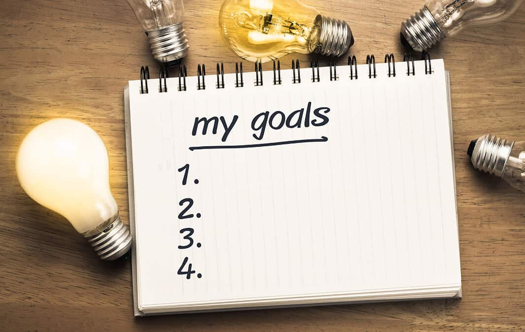 notepad for goals Setting goals? We've discovered the golden rules of goal setting to help you accomplish more in 2021.