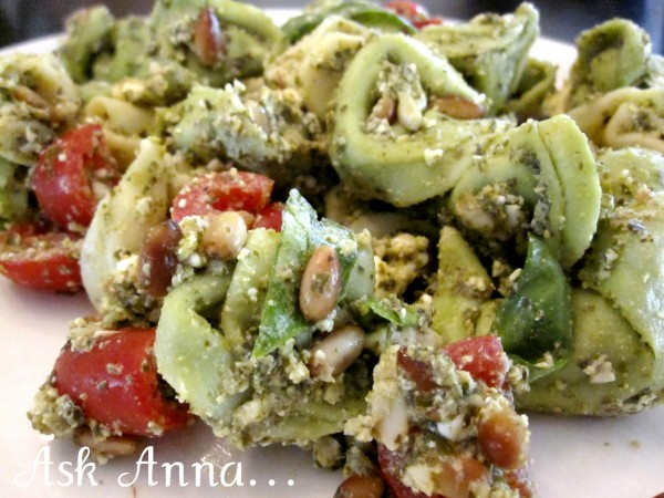 This basil, pesto, tortellini pasta salad is fresh and delicious, the perfect summer dinner or BBQ side dish. The fresh flavors of the basil, pesto and feta are balanced beautifully by the nuttiness of the pine nuts and creamy cheese tortellini. | Ask Anna