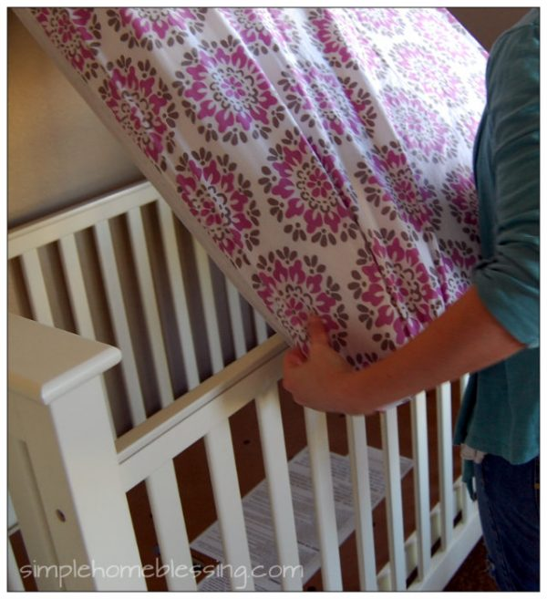 Quick and easy way to change a crib sheet *tutorial*