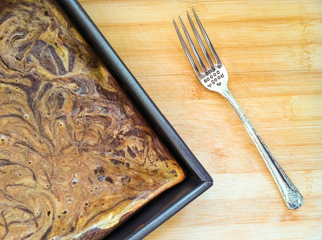 Delicious fudgy brownies topped with a moist layer of pumpkin cheesecake swirls. Chocolate meets pumpkin in this amazing fall dessert, just in time for Fall.