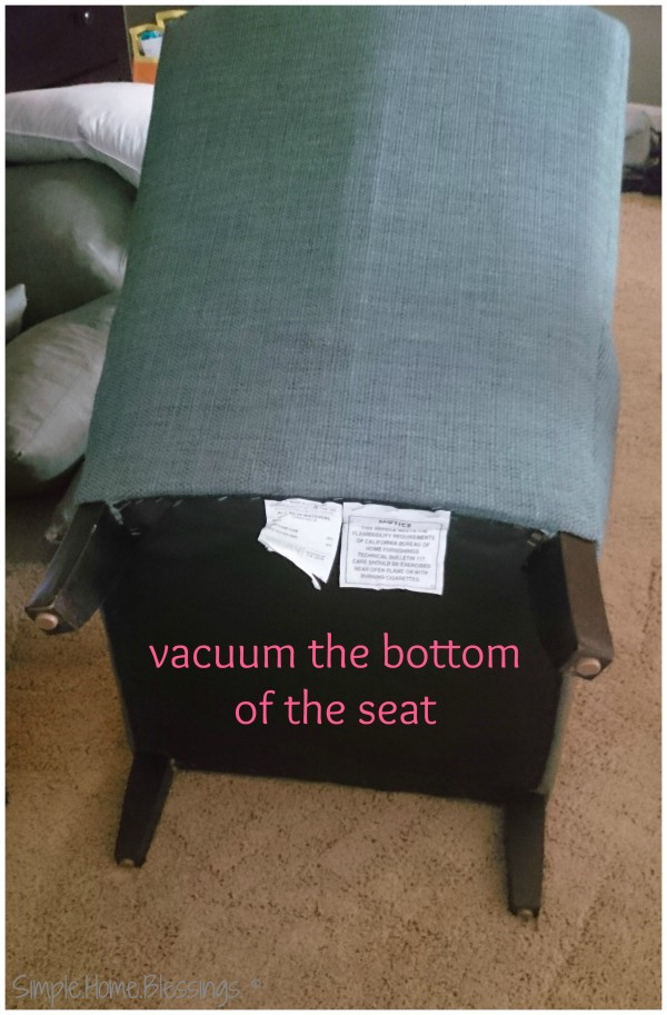 vacuum the bottom and back of the upholstered chair