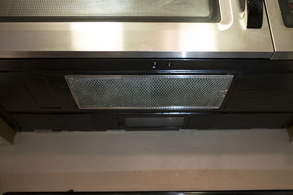 How to clean under the microwave