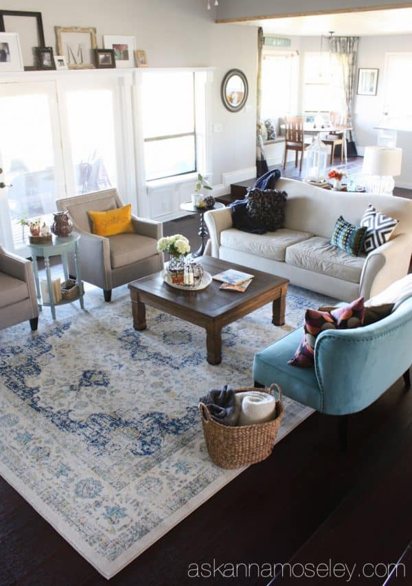 By adding a larger rug, a little more seating and the proper size coffee table, I was able to take my living room from boring to fabulous! - Ask Anna
