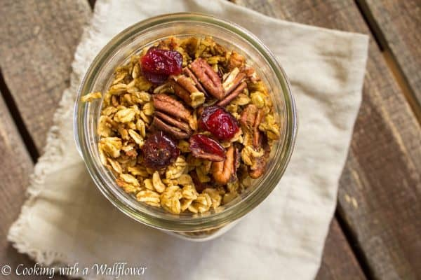 Granola filled with pumpkin puree, toasted pecans, sweet cranberries, and maple syrup. This maple pumpkin pecan granola is the most amazing breakfast and snack for fall.