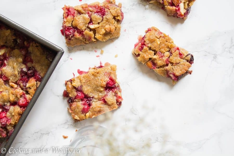 Sweet and tart fresh cranberries baked with a brown sugar butter crust on top. These cranberry crisp bars are so delicious and perfect for the holidays | Cooking With a Wallflower