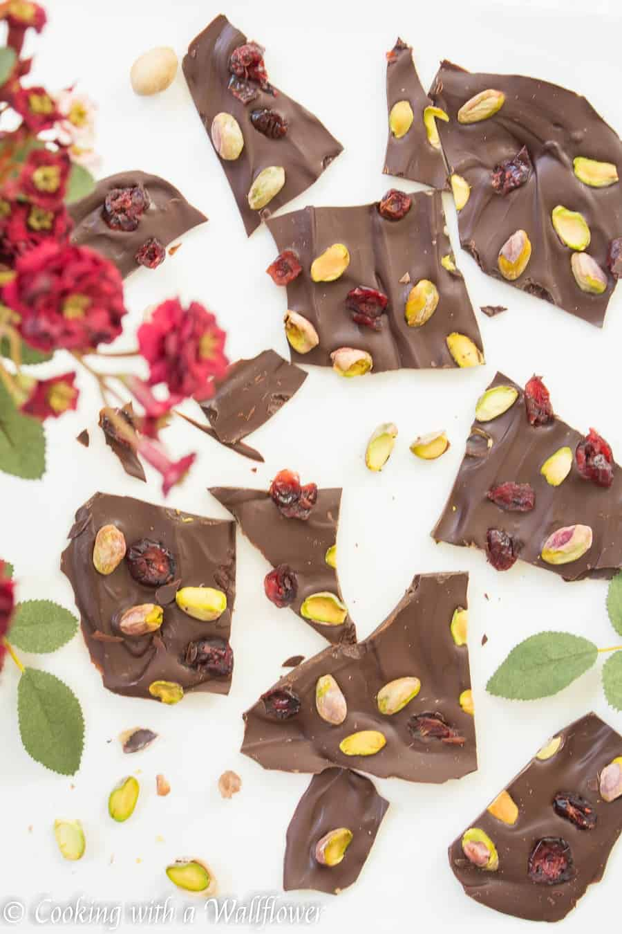 Semi sweet chocolate bark topped with sweet dried cranberries and salted pistachios. This cranberry pistachio chocolate bark is the perfect gift | Cooking With a Wallflower