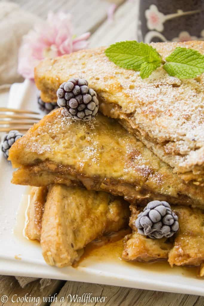 Thick crusty bread stuffed with cookie butter then dipped in a vanilla egg mixture. This cookie butter stuffed French toast is deliciously indulgent, perfect for brunch and special occasions like Mother's Day! | Cooking with a Wallflower