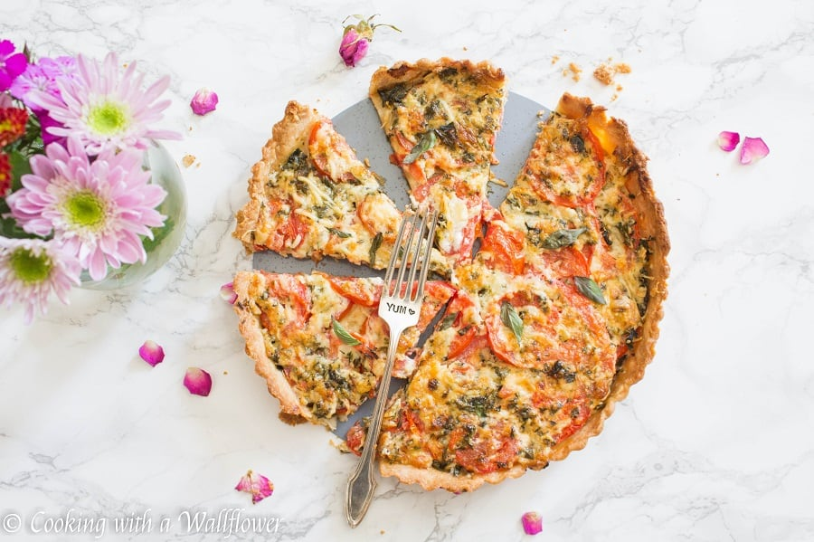 A delicious tart filled with fresh tomato, basil, and mozzarella cheese, this summer caprese tart is easy to put together and perfect for the summer   Cooking with a Wallflower