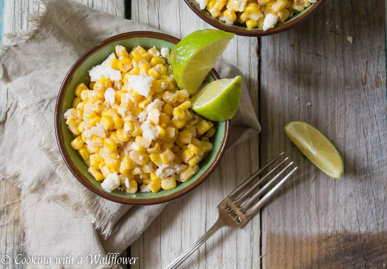 Corn kernels mixed with mayonnaise, melted butter, and queso fresco cheese then seasoned with chili powder and lime juice. This easy to make Mexican Street Corn is delicious and perfect as a side.   Cooking With a Wallflower