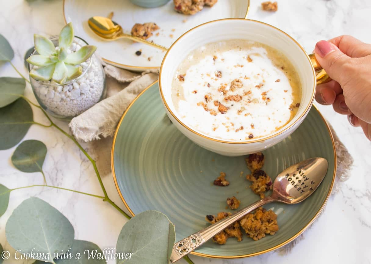 Strong brewed coffee latte served with pumpkin puree, maple syrup, and oats. This maple pumpkin almond oatmeal latte is delicious and perfect for fall.   Cooking With a Wallflower