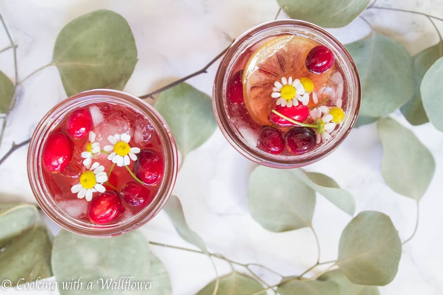 Hibiscus iced tea sweetened with cranberry simple syrup. This cranberry hibiscus iced tea delicious, refreshing and the perfect mocktail for the holidays. | Cooking with a Wildflower