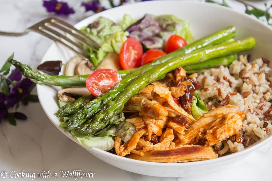 This honey chipotle chicken grain bowl is delicious and healthy! Mixed grains topped with honey chipotle chicken, roasted veggies, mixed greens, then drizzled with honey balsamic vinaigrette, it's the perfect quick and easy dinner! | Cooking with a Wallflower