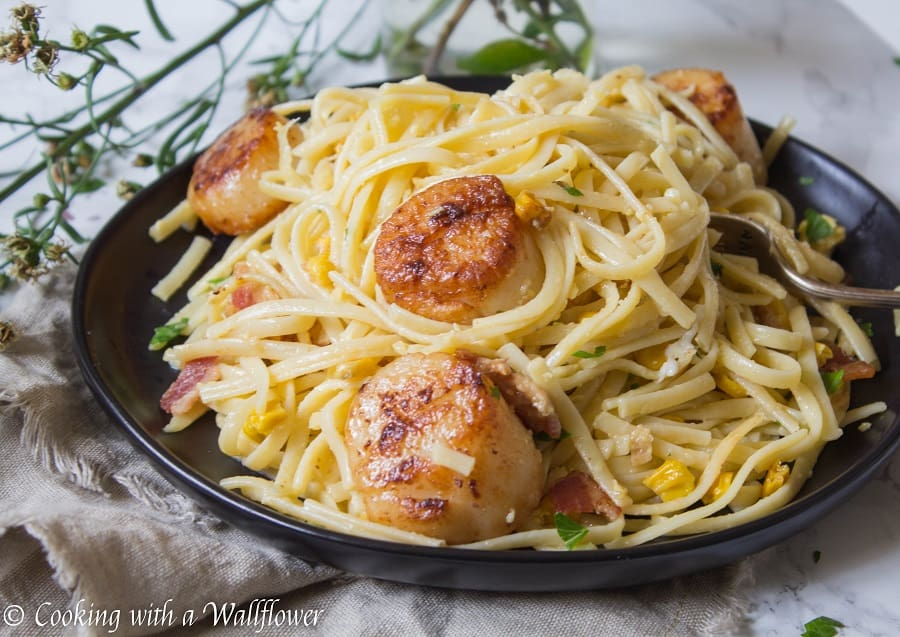 Pasta carbonara tossed with fresh corn and pan seared scallops is easier than it sounds! This Pasta Carbonara with Pan Seared Scallops is delicious and a great choice for a weeknight dinner.   Cooking with a Wallflower