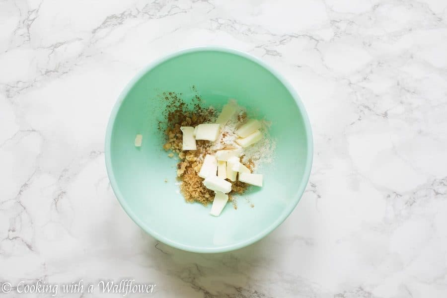 Caramelized figs topped with a buttery, crumble topping. This maple fig crumble is the perfect individually sized dessert for an early autumn dessert. | Cooking with a Wallflower